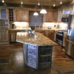 Wormy Butternut Kitchen with Hand hewn Island on Reclaimed End Grain and Original Face Oak Flooring