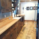 Reclaim Cabinets Paired with 8.5 inch Carriage House Pine Flooring with Soft Scrape Edges