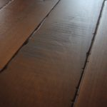 Skip Sawn Black Walnut Wood Floor with a Hard Scrape Edge